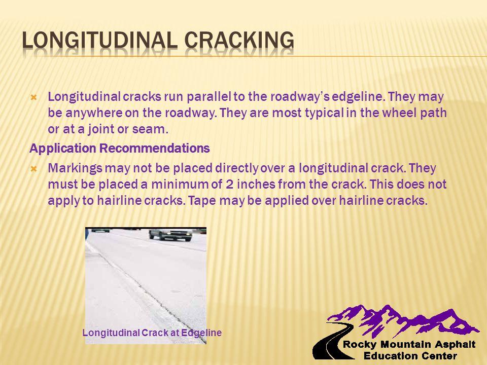  Longitudinal cracks run parallel to the roadway's edgeline.