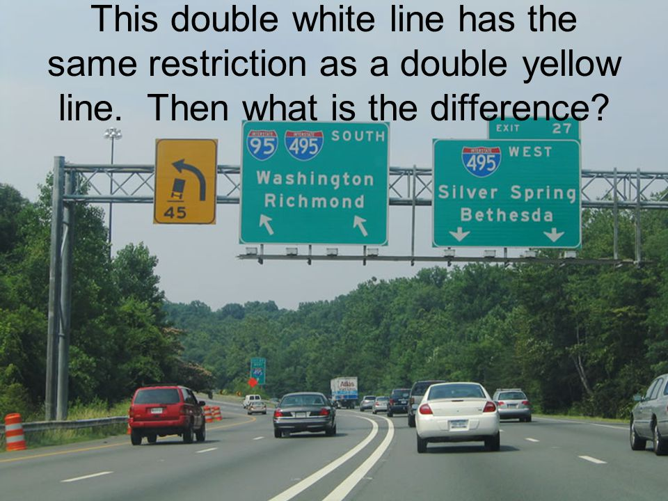 This double white line has the same restriction as a double yellow line. Then what is the difference?