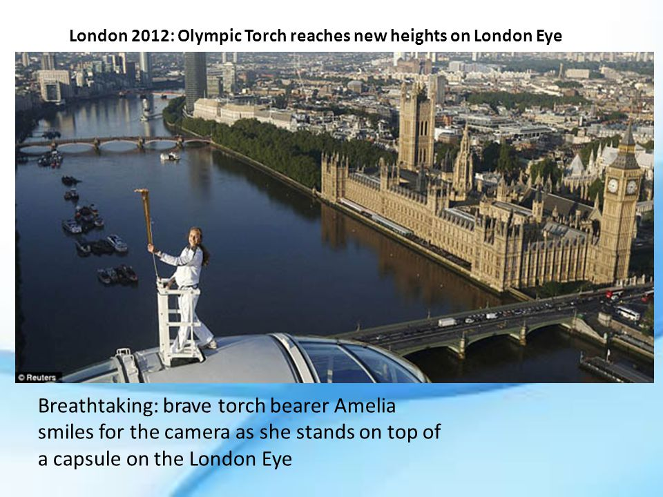 London 2012: Olympic Torch reaches new heights on London Eye Breathtaking: brave torch bearer Amelia smiles for the camera as she stands on top of a capsule on the London Eye