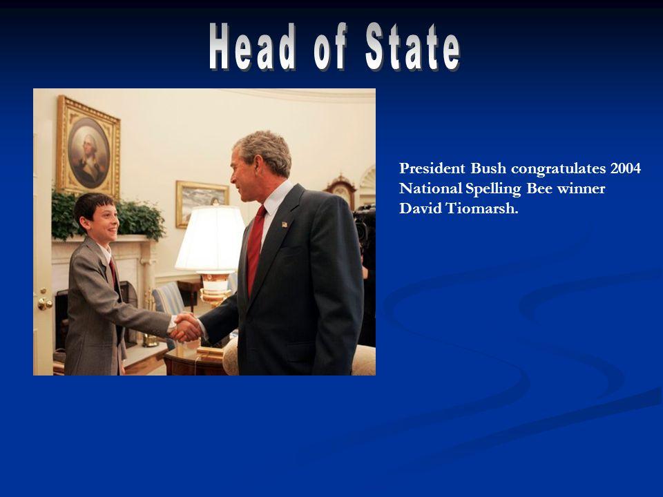President Bush congratulates 2004 National Spelling Bee winner David Tiomarsh.