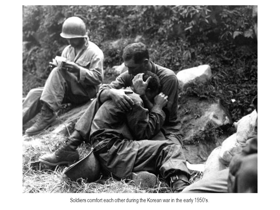 Soldiers comfort each other during the Korean war in the early 1950 s.