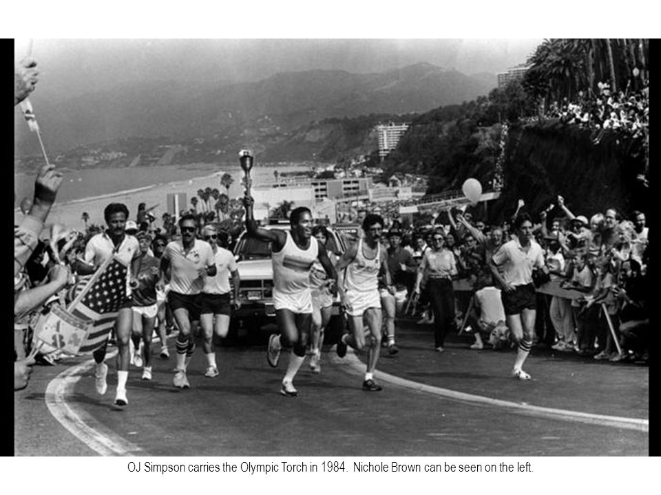 OJ Simpson carries the Olympic Torch in 1984. Nichole Brown can be seen on the left.
