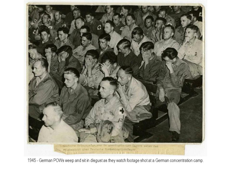 1945 - German POWs weep and sit in disgust as they watch footage shot at a German concentration camp.