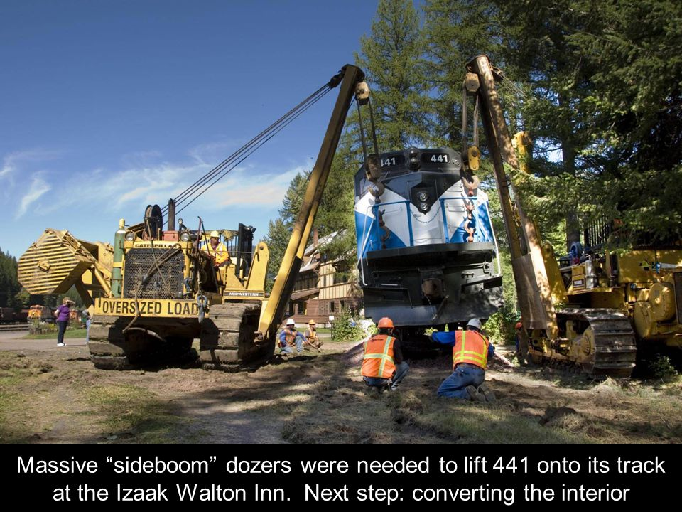 Massive sideboom dozers were needed to lift 441 onto its track at the Izaak Walton Inn.