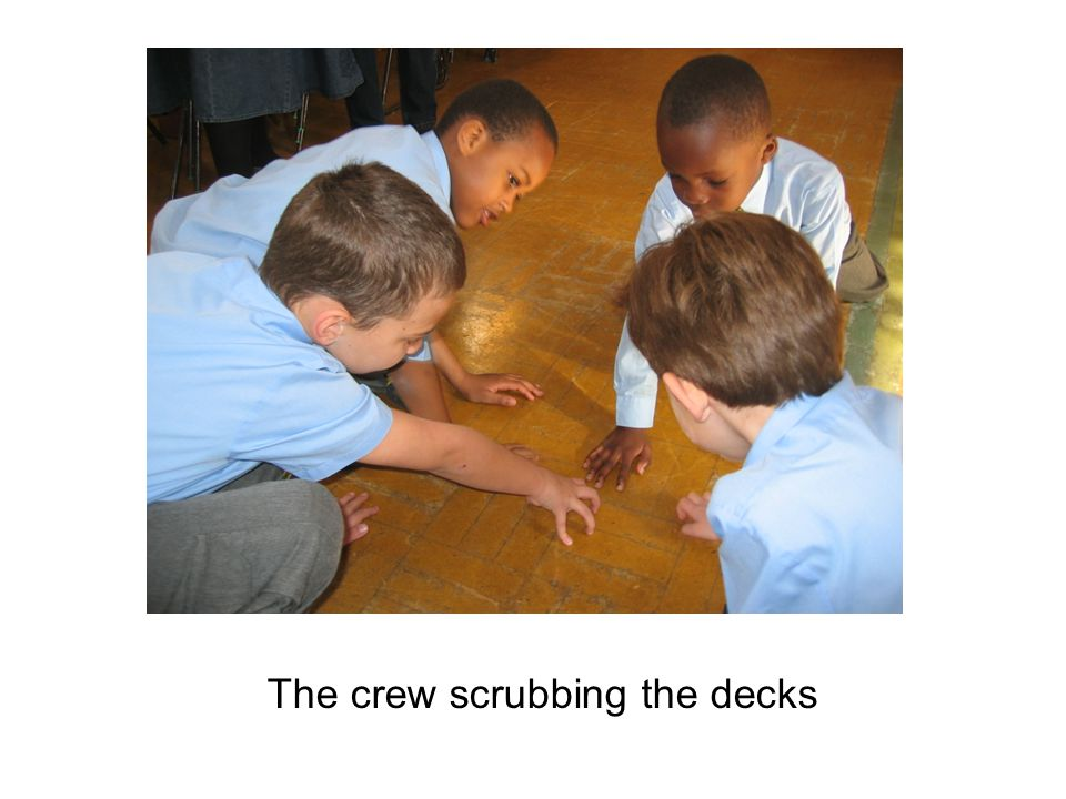 The crew scrubbing the decks