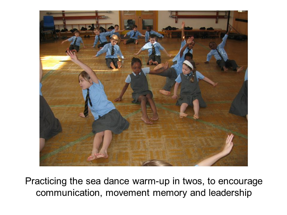 Practicing the sea dance warm-up in twos, to encourage communication, movement memory and leadership