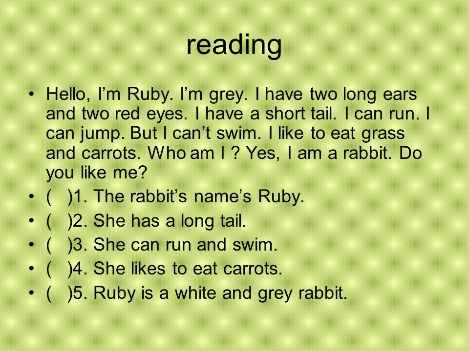 reading Hello, I'm Ruby. I'm grey. I have two long ears and two red eyes.