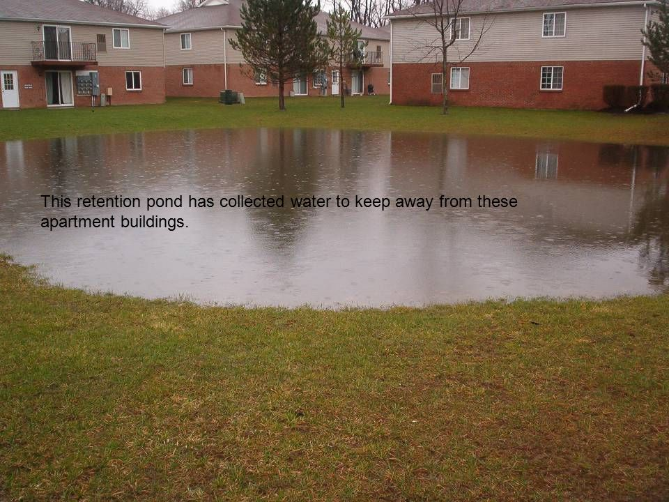 This retention pond has collected water to keep away from these apartment buildings.