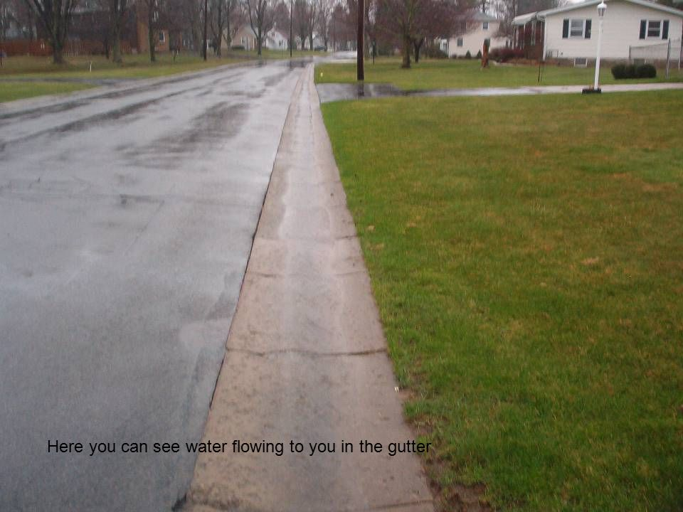 In this street there is no gutters or curbing so water flows down the shoulders.