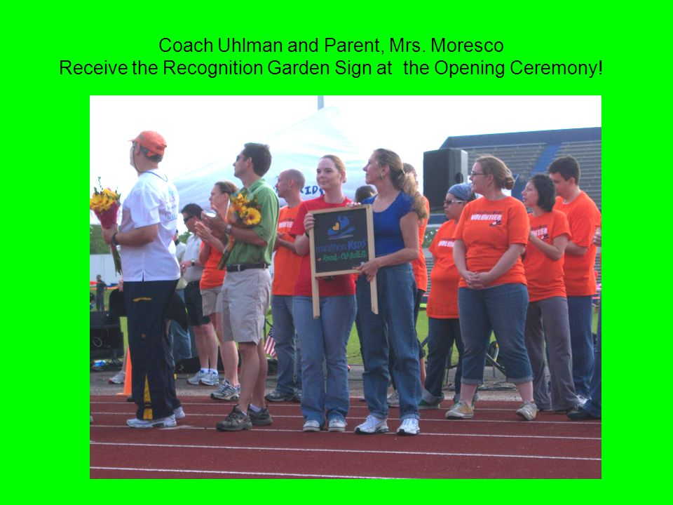 Coach Uhlman and Parent, Mrs. Moresco Receive the Recognition Garden Sign at the Opening Ceremony!