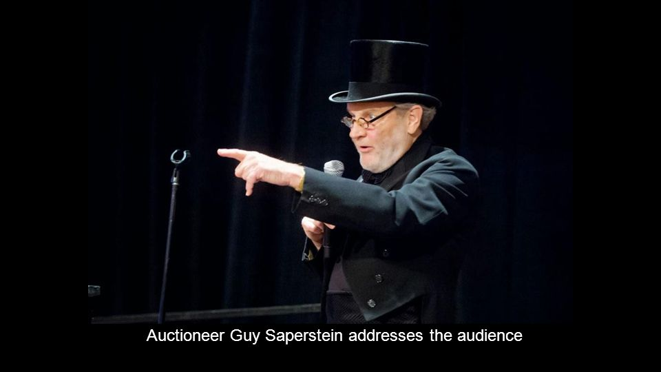 Auctioneer Guy Saperstein addresses the audience