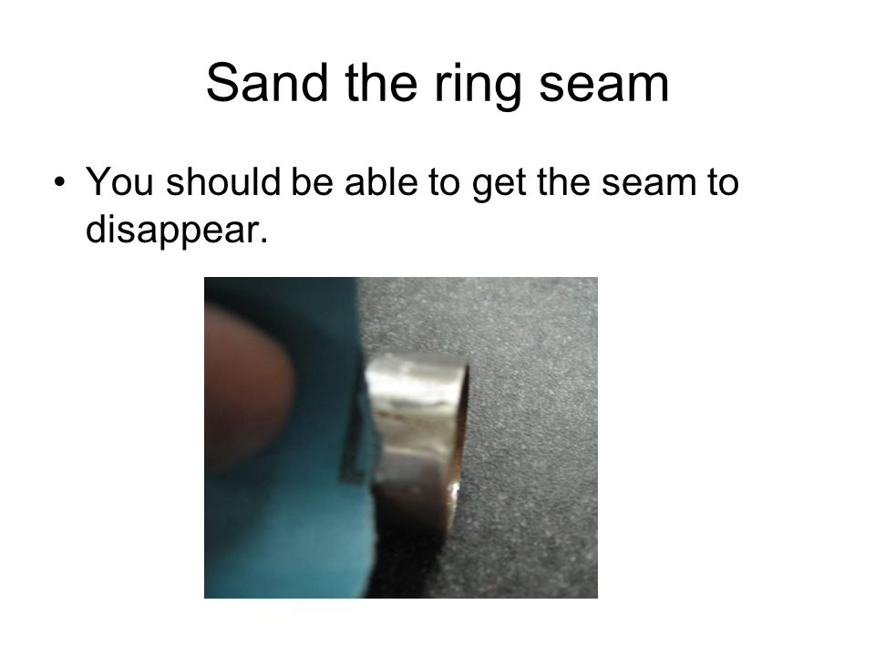 Sand the ring seam You should be able to get the seam to disappear.