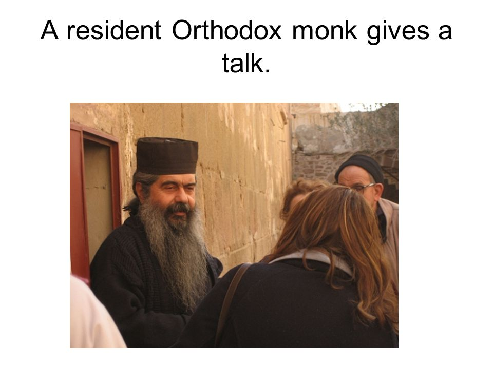 A resident Orthodox monk gives a talk.