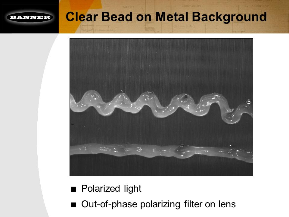 Clear Bead on Metal Background ■ Polarized light ■ Out-of-phase polarizing filter on lens