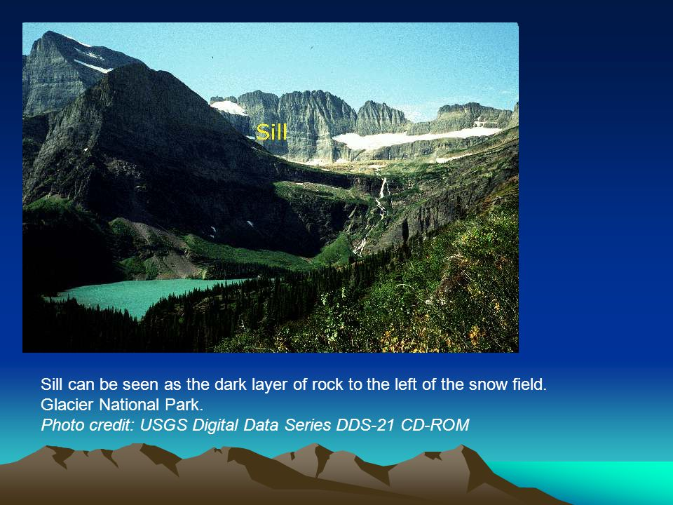 Sill can be seen as the dark layer of rock to the left of the snow field.