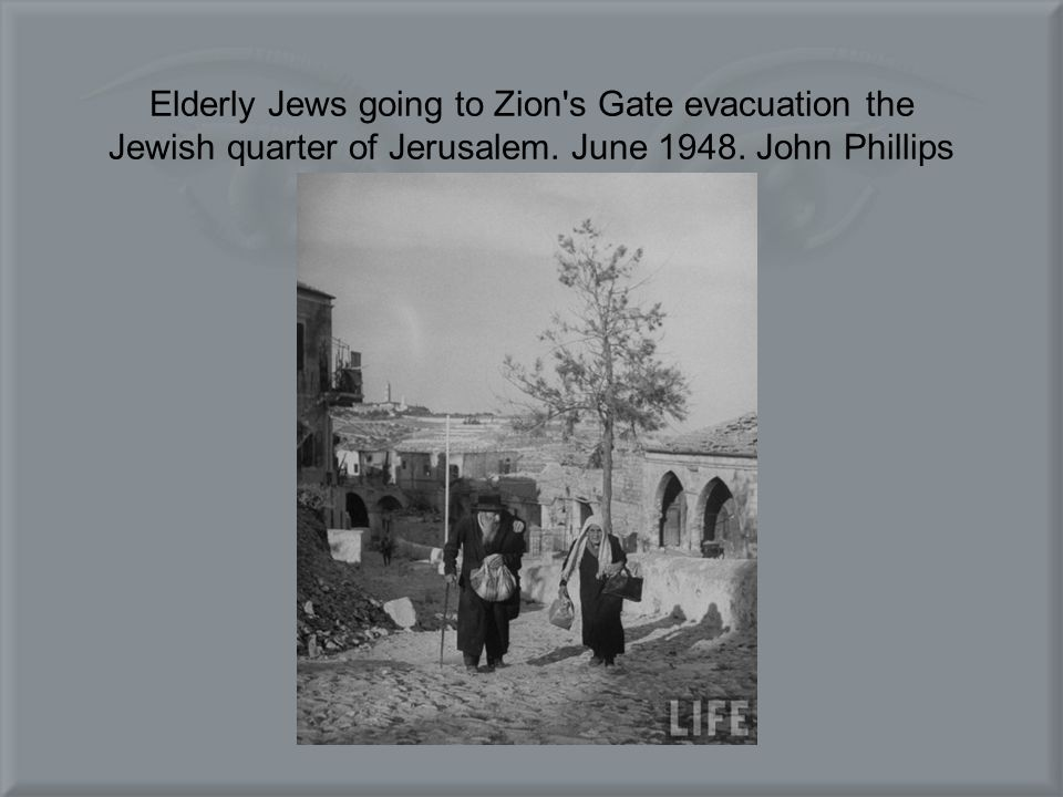 Elderly Jews going to Zion's Gate evacuation the Jewish quarter of Jerusalem. June 1948. John Phillips