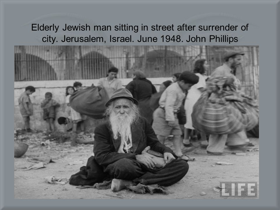 Elderly Jewish man sitting in street after surrender of city. Jerusalem, Israel. June 1948. John Phillips
