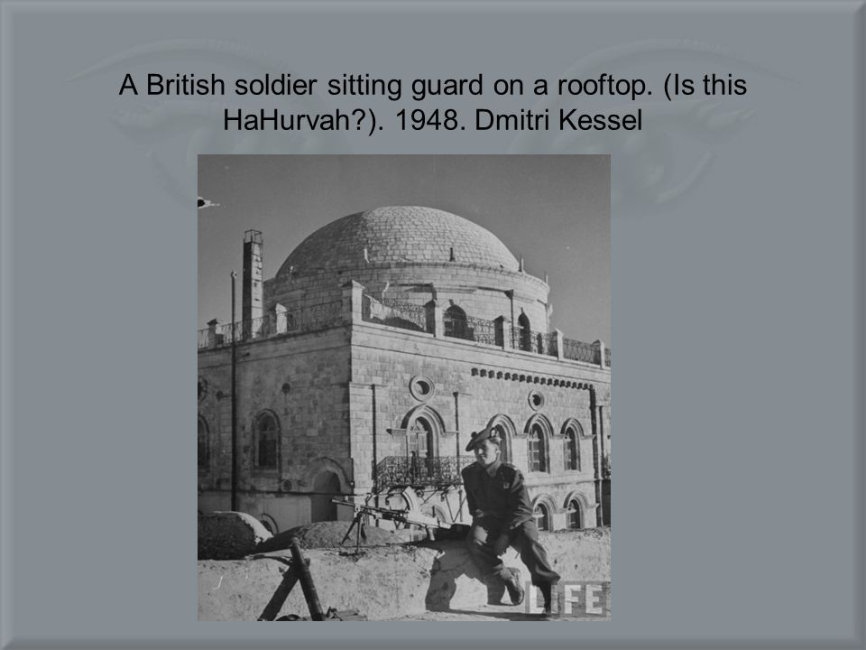 A British soldier sitting guard on a rooftop. (Is this HaHurvah ). 1948. Dmitri Kessel