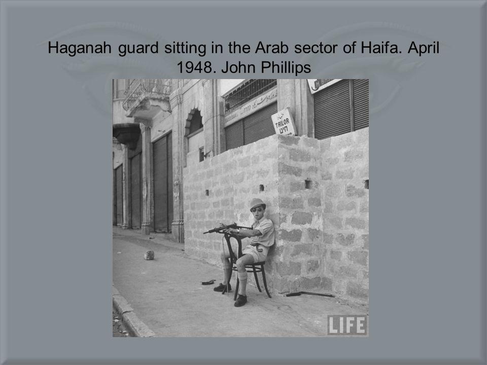 Haganah guard sitting in the Arab sector of Haifa. April 1948. John Phillips