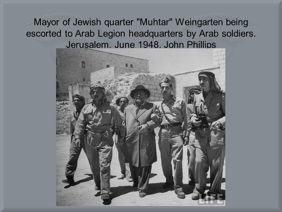 Mayor of Jewish quarter Muhtar Weingarten being escorted to Arab Legion headquarters by Arab soldiers.