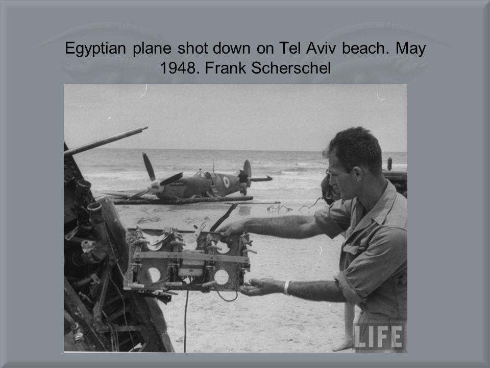 Egyptian plane shot down on Tel Aviv beach. May 1948. Frank Scherschel