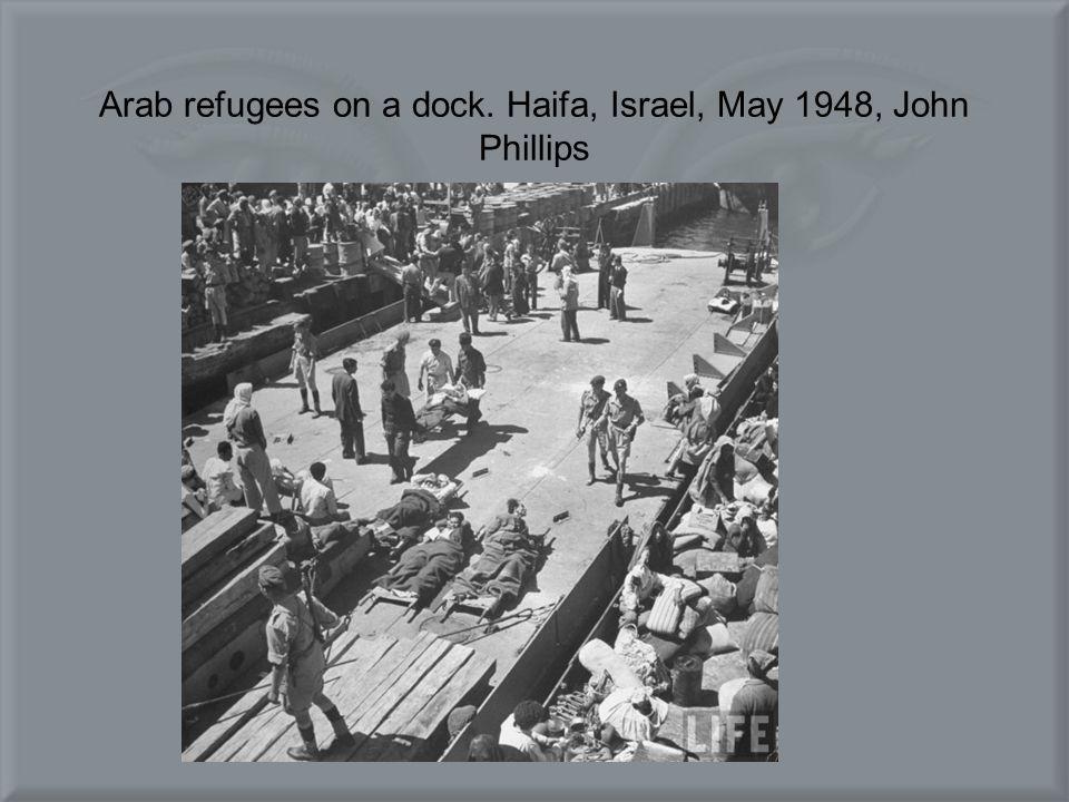 Arab refugees on a dock. Haifa, Israel, May 1948, John Phillips