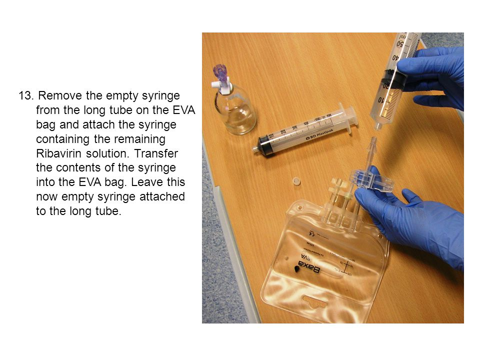 13. Remove the empty syringe from the long tube on the EVA bag and attach the syringe containing the remaining Ribavirin solution. Transfer the conten