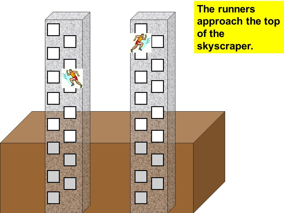 The runners approach the top of the skyscraper.