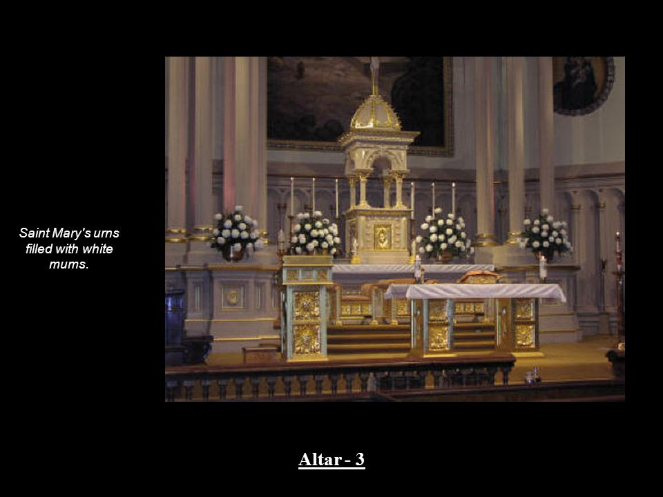Saint Mary s urns filled with white mums. Altar - 3
