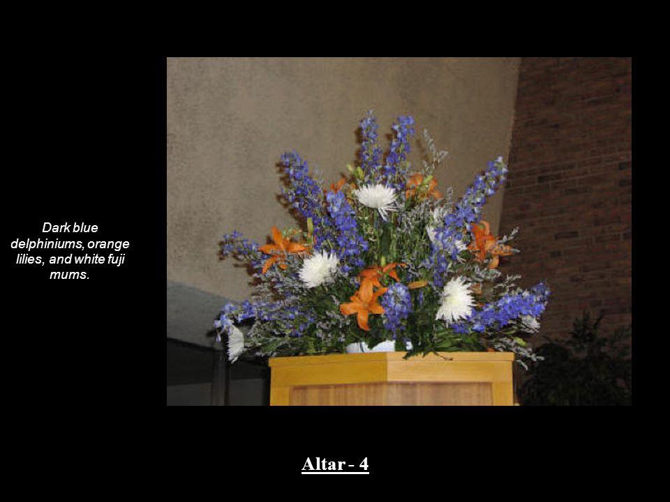 Dark blue delphiniums, orange lilies, and white fuji mums. Altar - 4