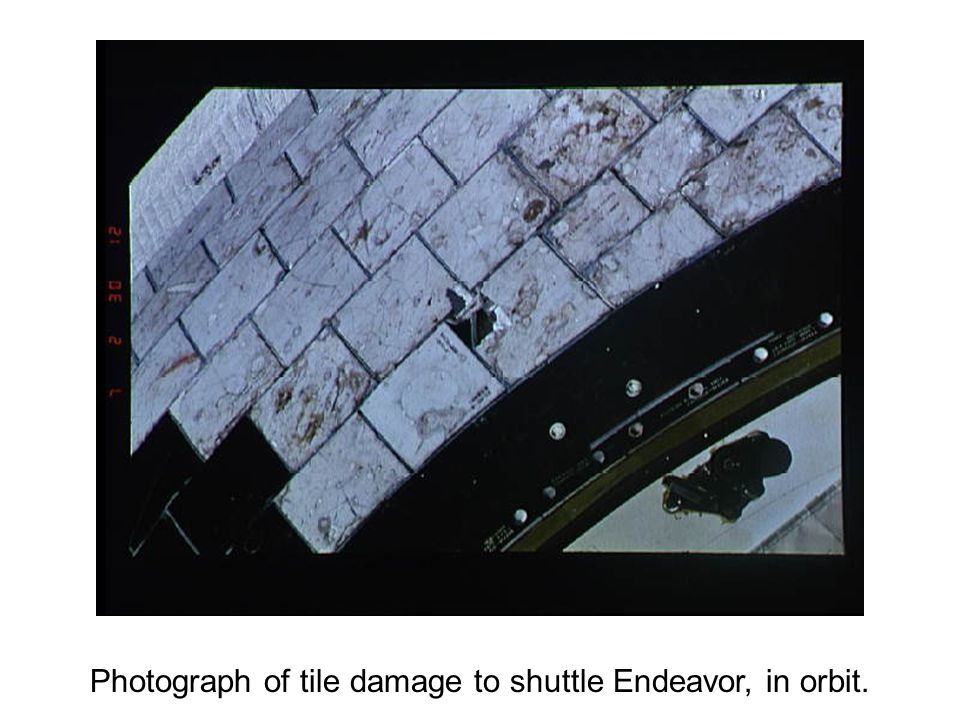 Photograph of tile damage to shuttle Endeavor, in orbit.