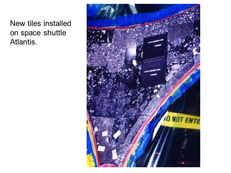 New tiles installed on space shuttle Atlantis.