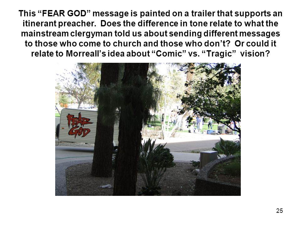 This FEAR GOD message is painted on a trailer that supports an itinerant preacher.