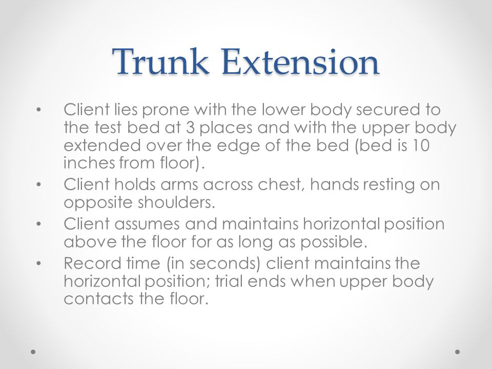 Trunk Extension Client lies prone with the lower body secured to the test bed at 3 places and with the upper body extended over the edge of the bed (b