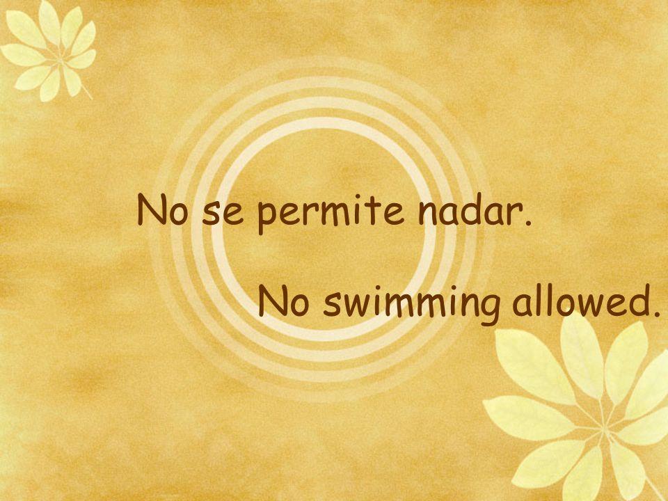 No se permite nadar. No swimming allowed.