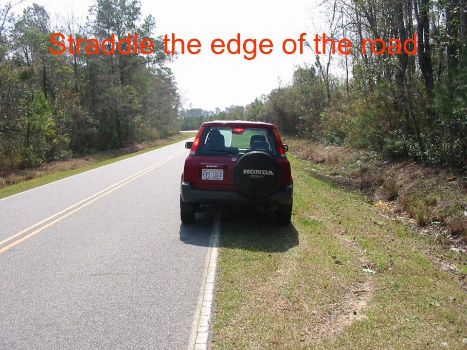 Straddle the edge of the road