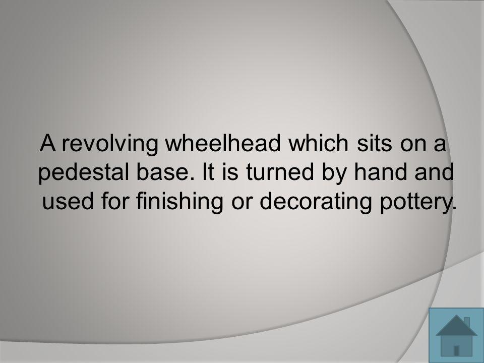 A revolving wheelhead which sits on a pedestal base.