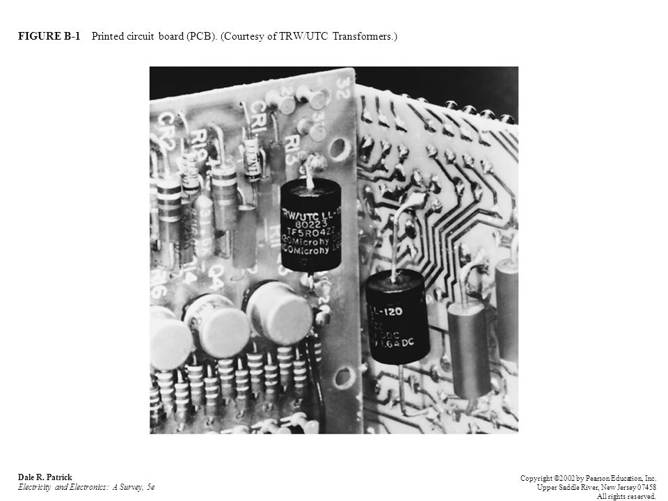 FIGURE B-1 Printed circuit board (PCB). (Courtesy of TRW/UTC Transformers.) Dale R.