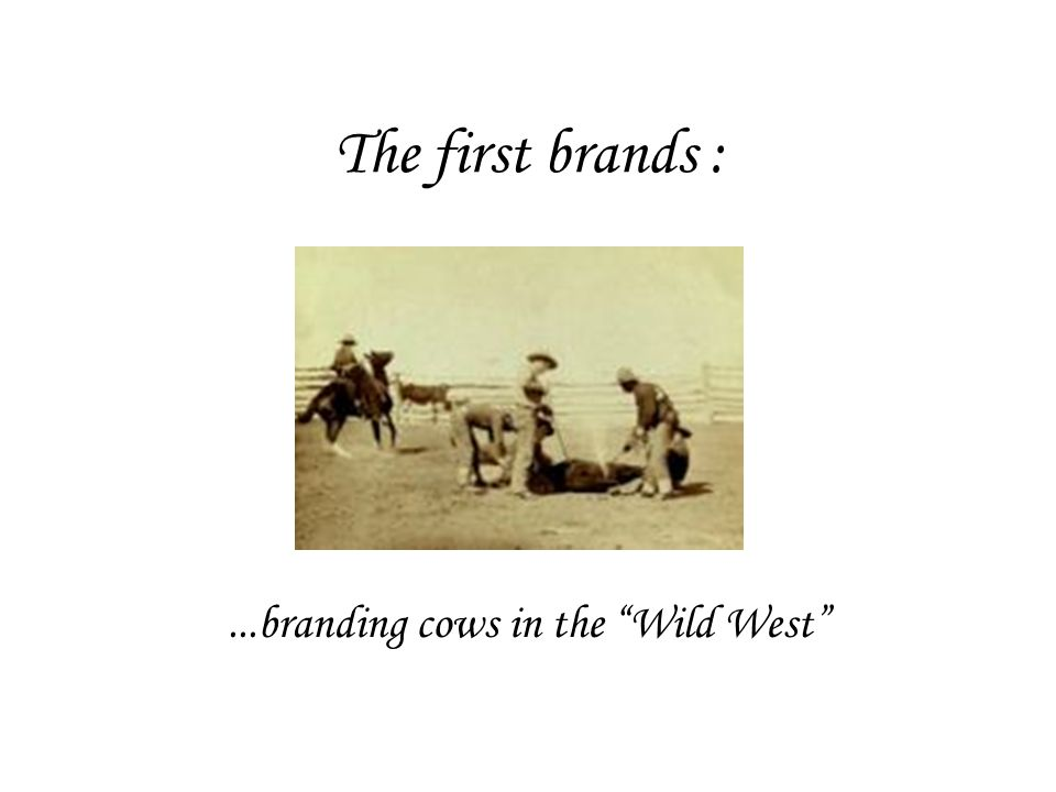 The first brands :...branding cows in the Wild West