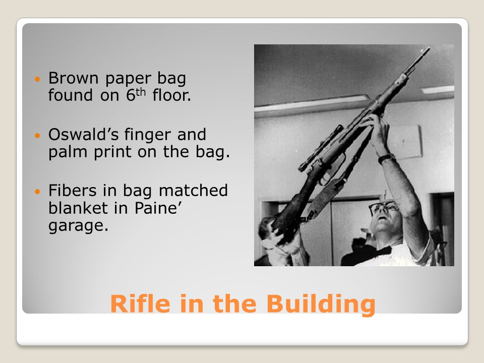 Rifle in the Building Rifle in blanket of Paine's garage missing. Told Frazier he had curtain rods in brown package. Frazier saw Oswald hurriedly carr