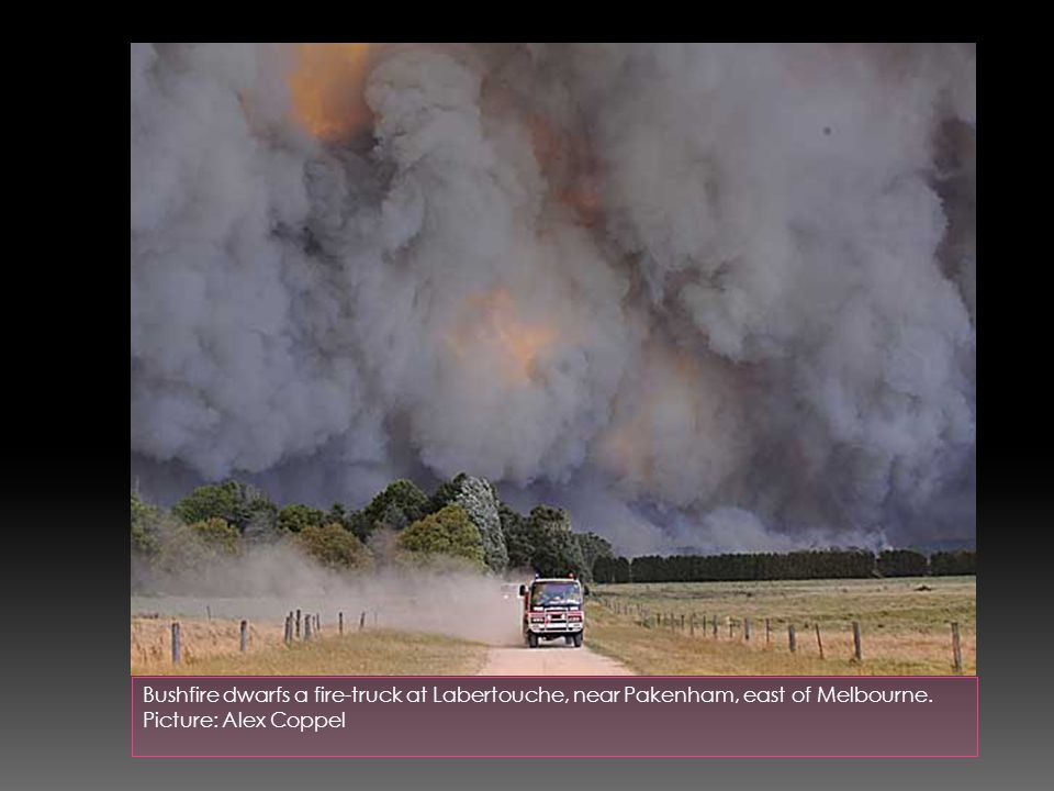 Bushfire dwarfs a fire-truck at Labertouche, near Pakenham, east of Melbourne. Picture: Alex Coppel