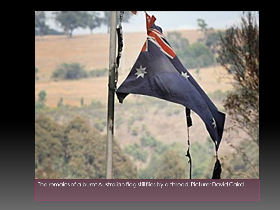 The remains of a burnt Australian flag still flies by a thread. Picture: David Caird