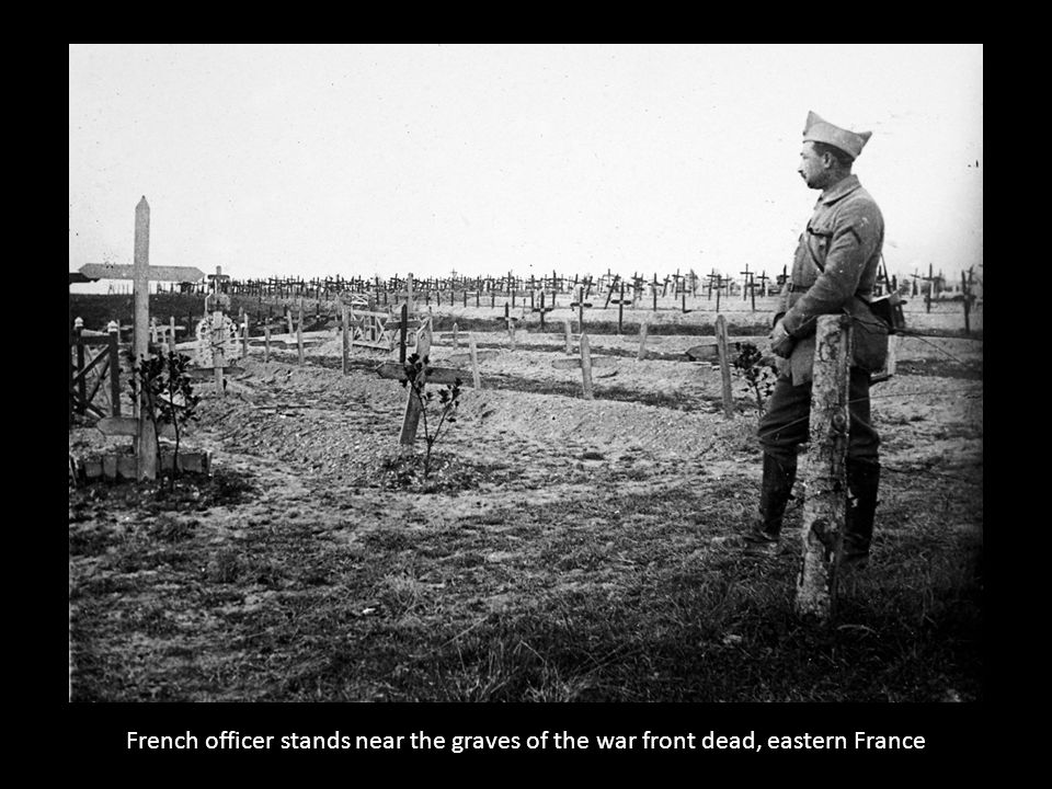French officer stands near the graves of the war front dead, eastern France