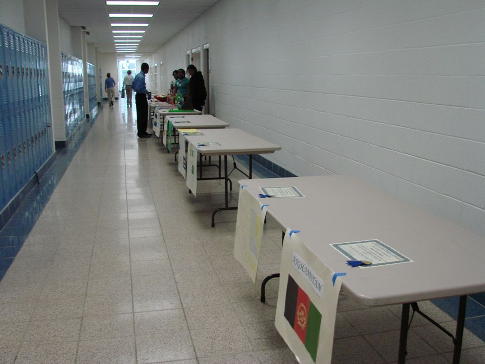 Beginning in the cafeteria, Traditional AWED booths will be arranged in alphabetical order by country and then by each student's last name.