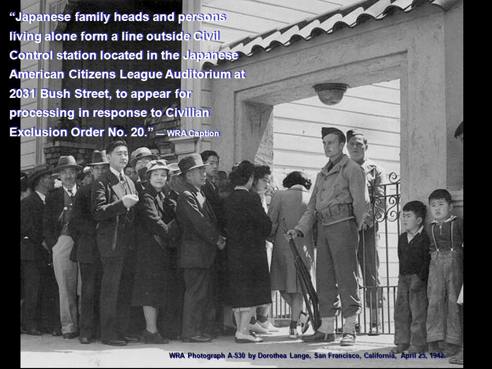 """Japanese family heads and persons living alone form a line outside Civil Control station located in the Japanese American Citizens League Auditorium"