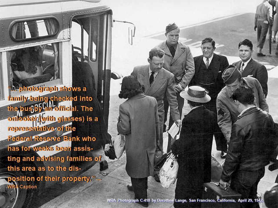 """... photograph shows a family being checked into the bus by an official. The onlooker (with glasses) is a representative of the Federal Reserve Bank"