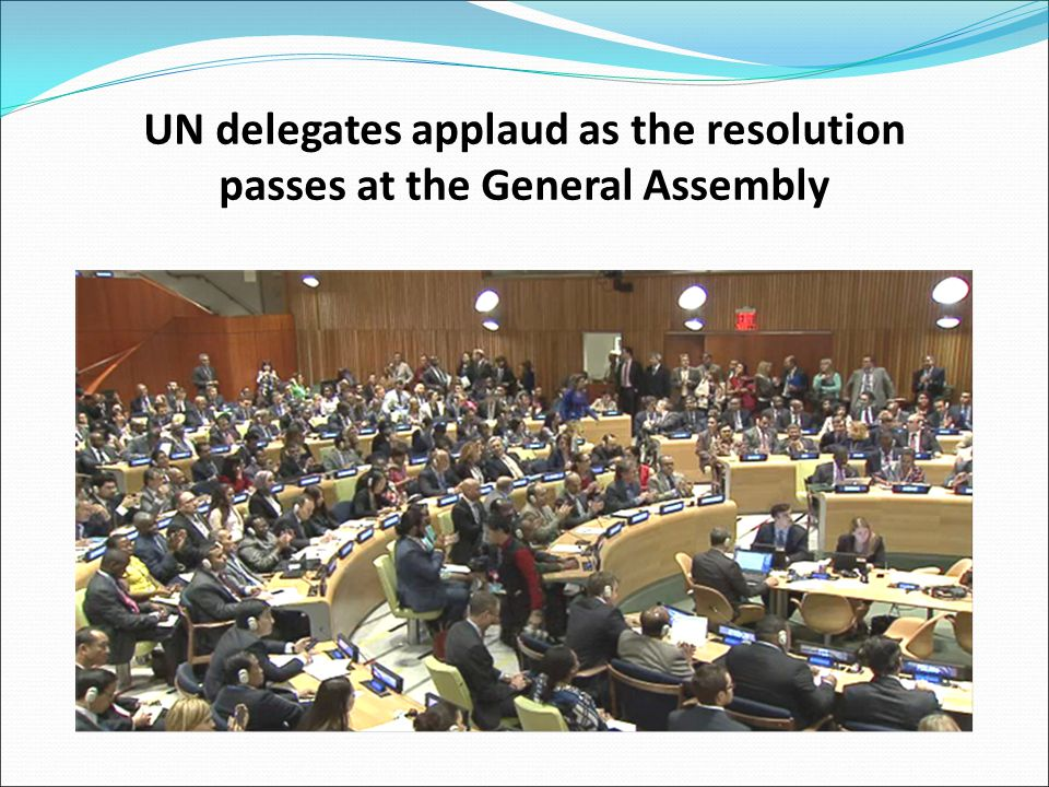 UN delegates applaud as the resolution passes at the General Assembly