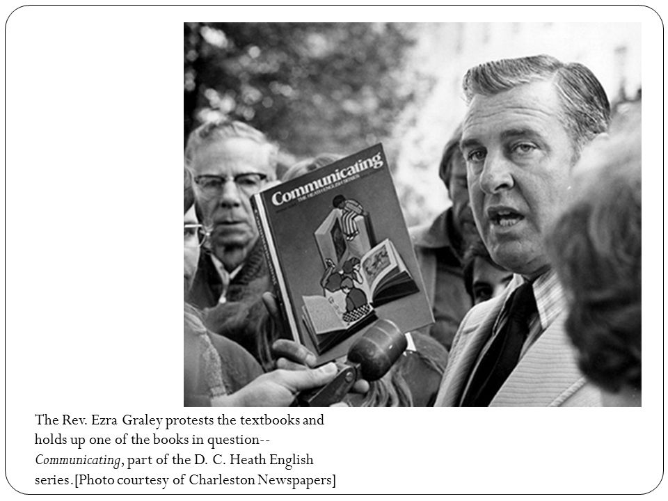 The Rev. Ezra Graley protests the textbooks and holds up one of the books in question-- Communicating, part of the D. C. Heath English series.[Photo c