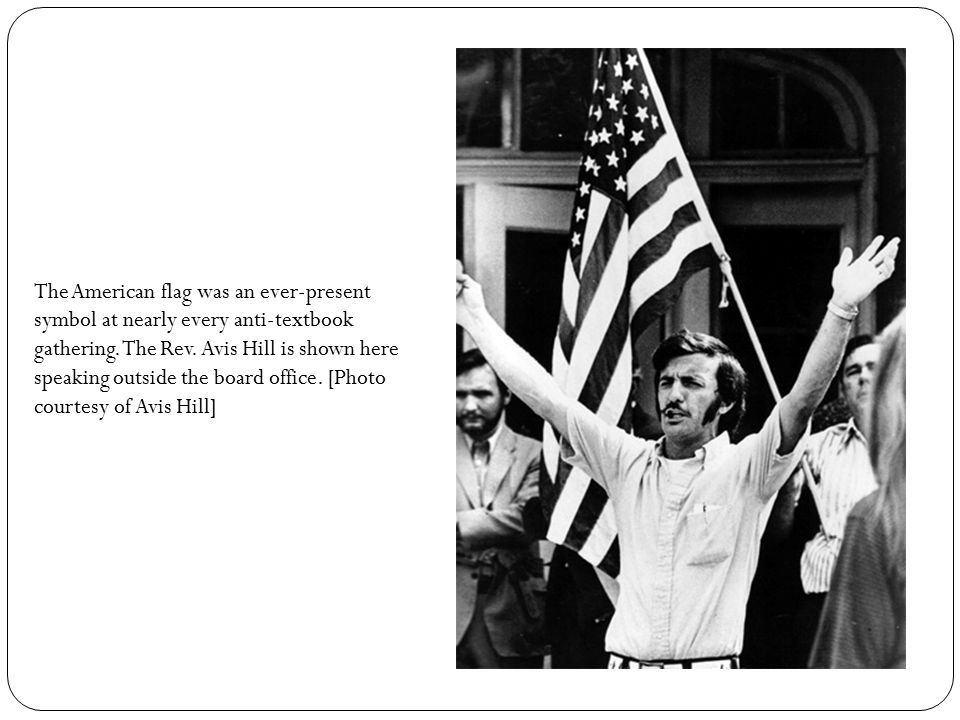 The American flag was an ever-present symbol at nearly every anti-textbook gathering. The Rev. Avis Hill is shown here speaking outside the board offi