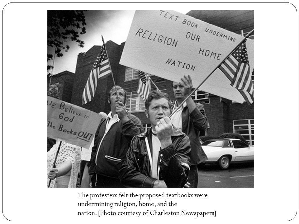 Klansman Dale Reusch attends a January 1975 anti-textbook rally; the Rev.